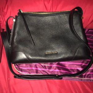 Michael Kors Black leather bag w/ side gold locks